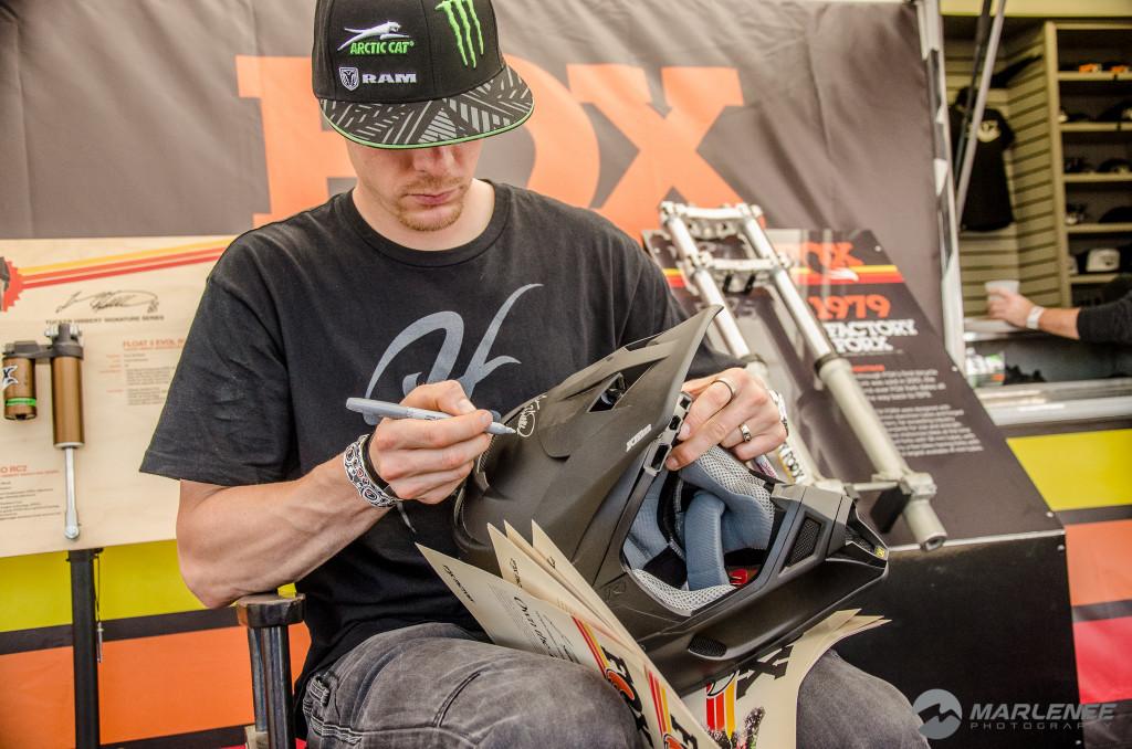 Tucker Hibbert signing a Klim helmet