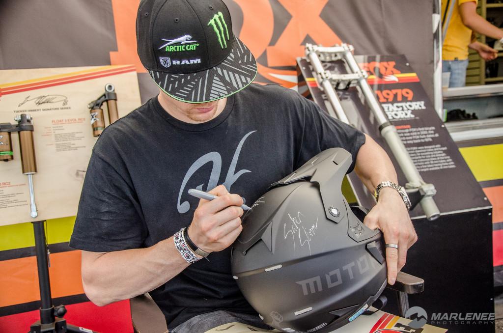 Tucker Hibbert signs a Motorfist Helmet