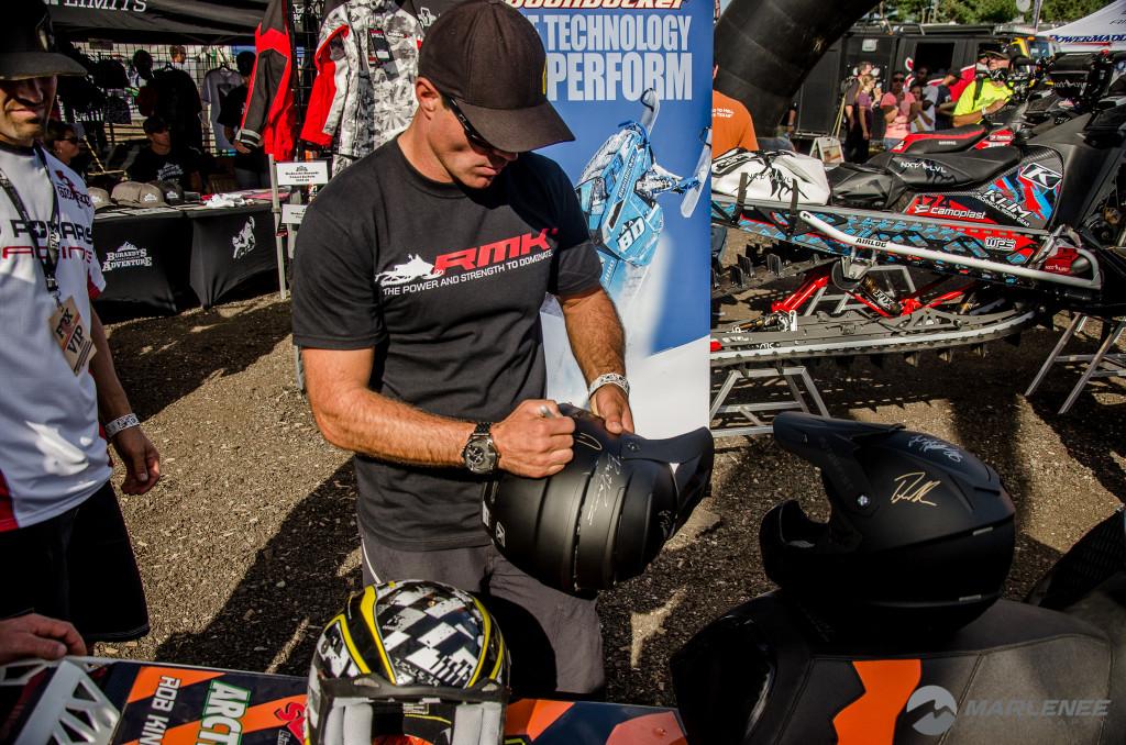 Dan Adams signing a Klim helmet