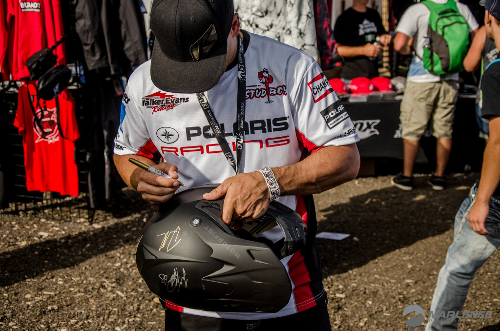 Cole Willford signs a Motorfist Helmet