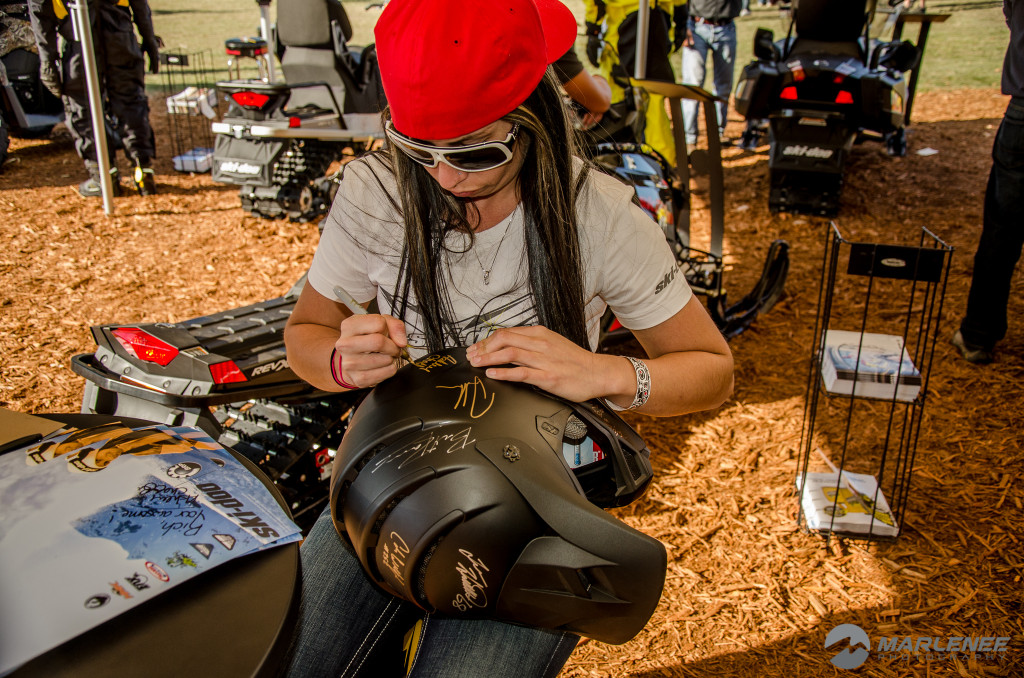 Ashley Chaffin signing a Klim helmet