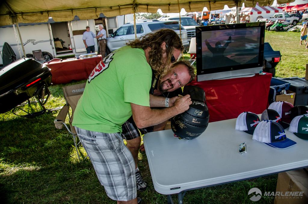 Brandon 'TuDizzle' Cox signing a Klim helmet