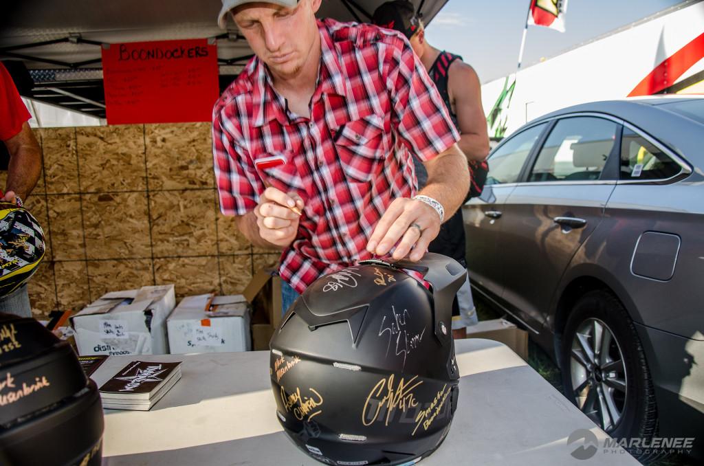 Matt Entz signs a Motorfist Helmet