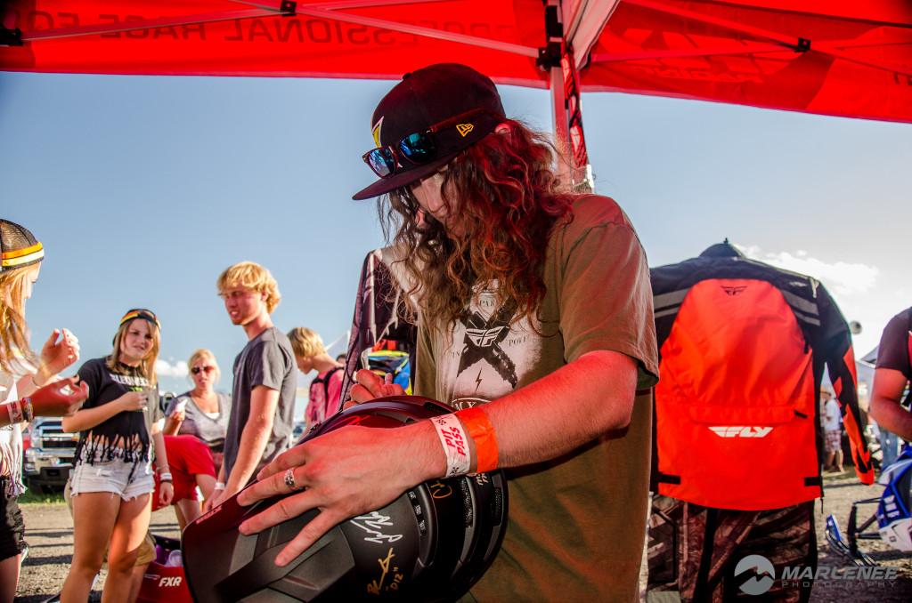 Colten Moore signing a Klim helmet