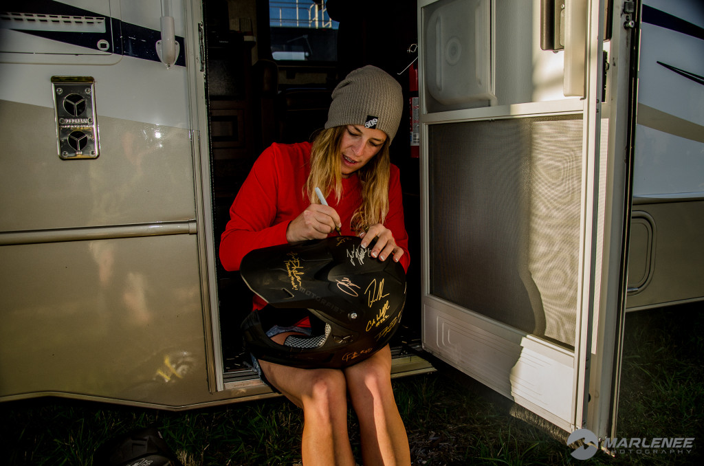 Juilie-Ann Chapman signs a Motorfist Helmet