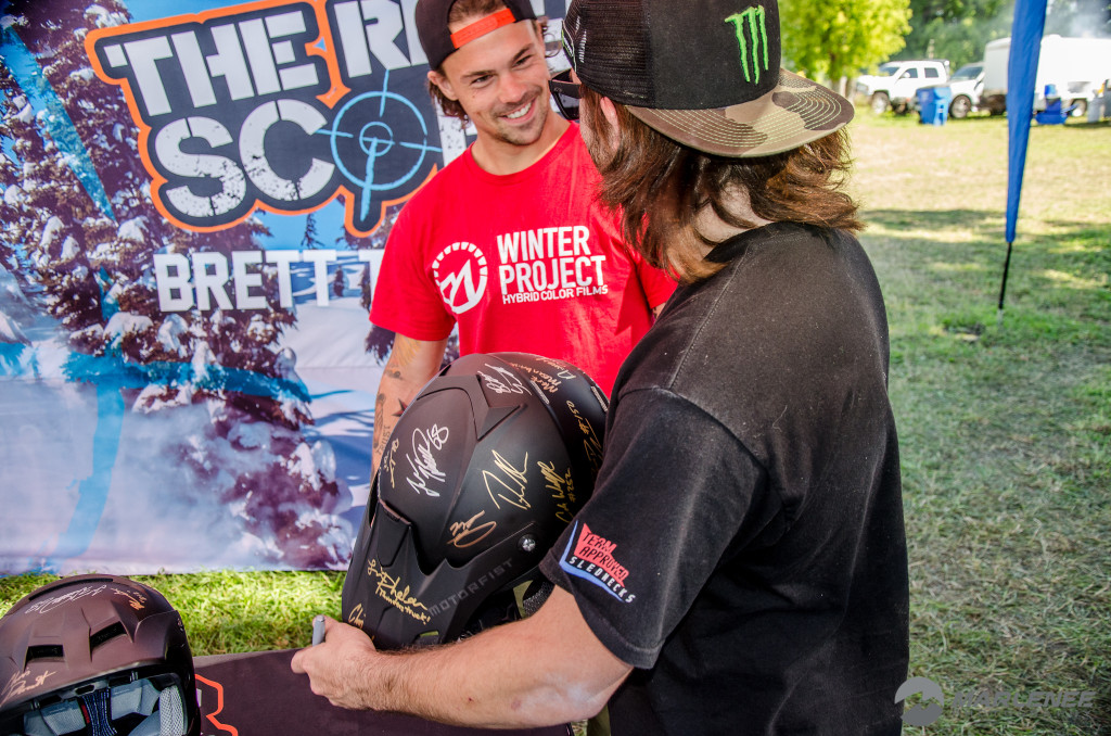 Brett Turcotte and Josh Penner sign a Motorfist Helmet