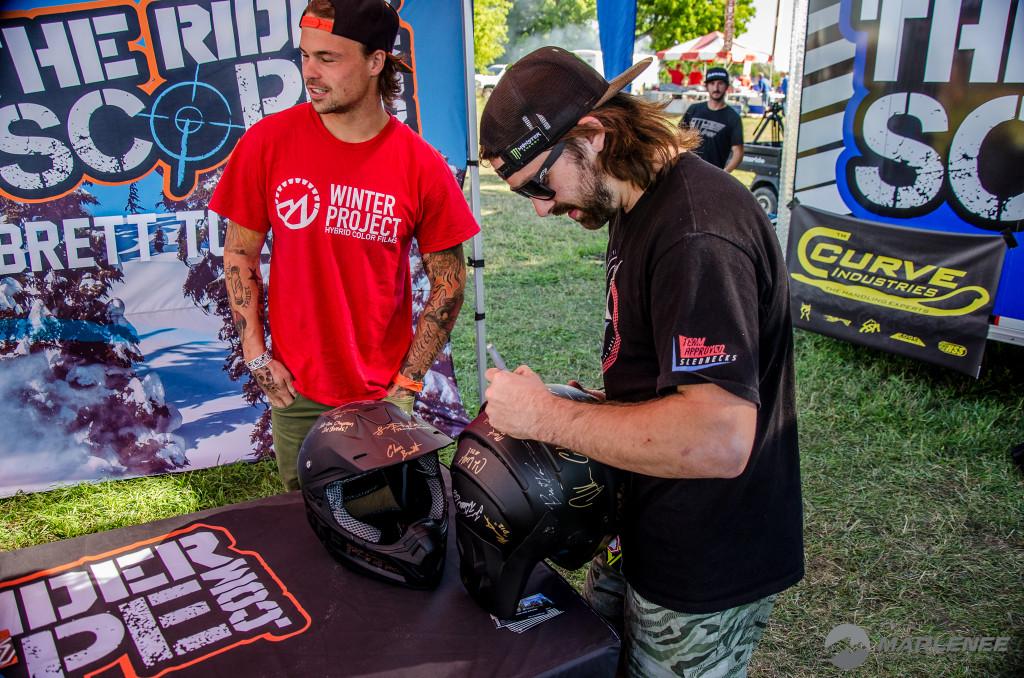 Brett Turcotte signing a Klim helmet