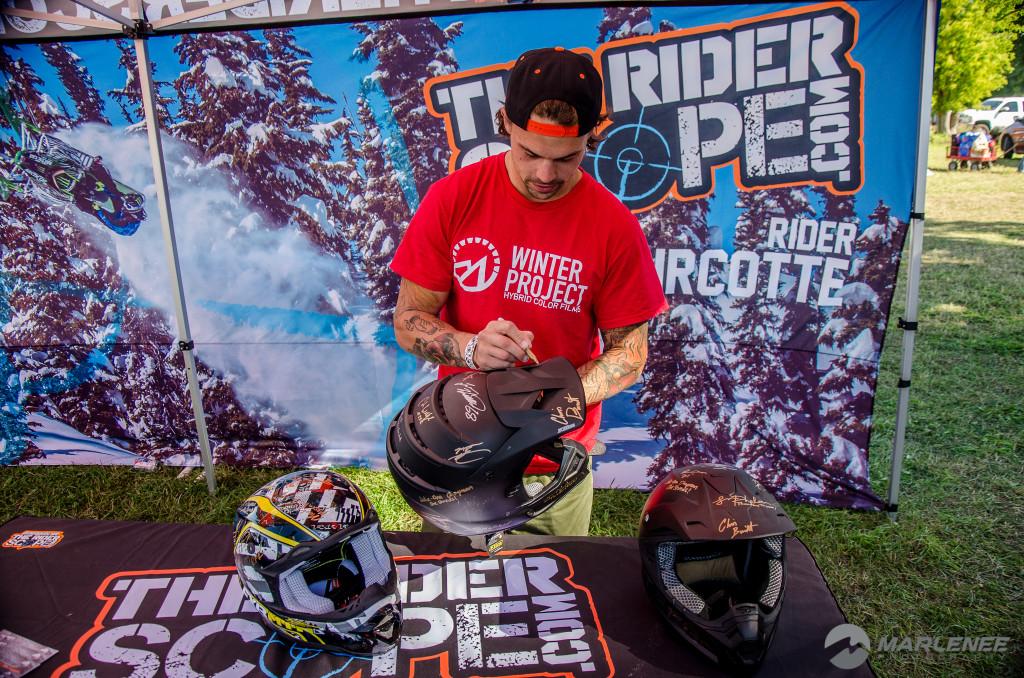 Josh Penner signing a Klim helmet