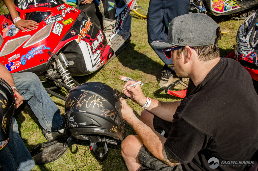 Paul Thacker signs a Motorfist Helmet