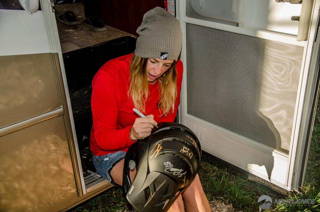 Julie-Ann Chapman signing a Klim helmet