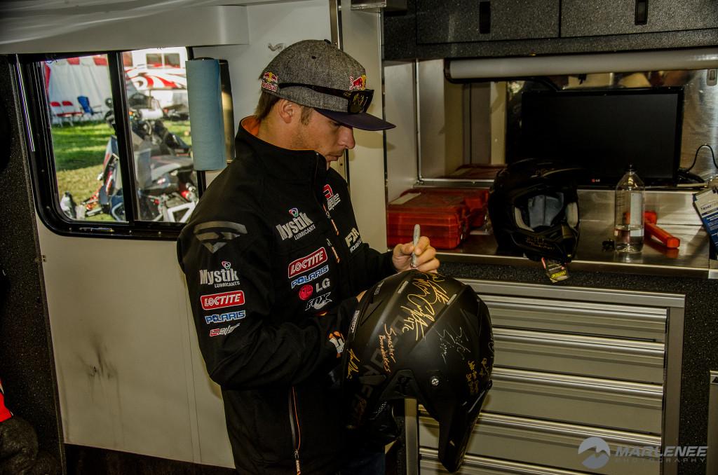 Levi LaVallee signs a Motorfist Helmet